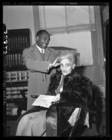 Allan Woods, 28 fixes hair of his fiancee, Adriana Eugenie Nicolson, 90 in Los Angeles, Calif., 1949