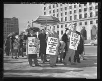 CIO pickets carrying Stalin masks in parade at Los Angeles Federal Building, 1949
