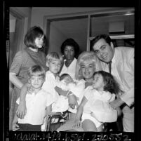Actress Jayne Mansfield with husband Matt and family leaving Hospital with their newborn son, Antonio in Los Angeles, Calif., 1965