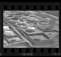 Aerial view of tanks, one painted as a jack-o-lantern, at Union Oil Co. refinery in Wilmington, Calif., 1965