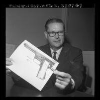 Criminologist Allen E. Gilmore holding MB Associates gyro-jet hand gun, Los Angeles, Calif., 1965