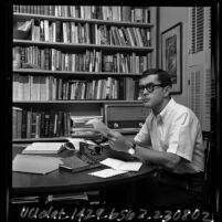Cal State Los Angeles Poet-in-Residence Henri Coulette seated in his study, 1965