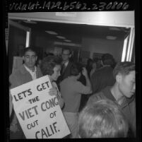 UCLA student from Bruin Young Republicans being turned away from campus teach-in on Vietnam, 1965