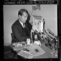 William Longstreth, chairman of the UCLA Victory in Vietnam Assn., displaying pro-Red literature, 1965