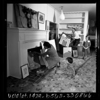 Art collector-Housewife Diana Zlotnick with family displaying part of her collection in North Hollywood, Calif., 1965