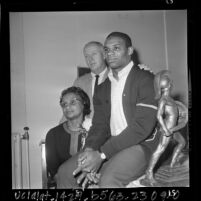 USC football player Mike Garrett with his mother and coach John McKay after winning Heisman Trophy, 1965