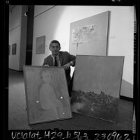 Artist John Paul Jones, displaying three of the paintings from his exhibit at Los Angeles County Museum of Art, 1965