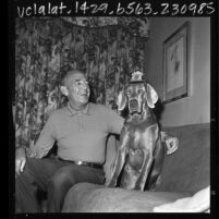 Los Angeles Police Chief William H. Parker with his dog, Lex, 1965
