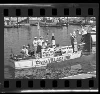 Boat in the Sculling and Punting Society parade along Balboa Island, Calif., 1965