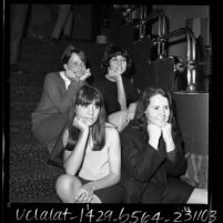 Four women seated on stairs at Dave Hull's Hullabaloo club on Sunset Blvd. in Los Angeles, Calif., 1965