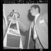 Jim Fregosi, shortstop for California Angels, with model of Anaheim Stadium scoreboard, 1965