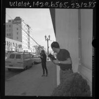 Brad Ignatowski and Karen Sweeney trying out their Christmas gift, walkie-talkies, Los Angeles, Calif., 1965