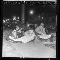 Williams family bedding down on Colorado Blvd. in wait for the Rose Parade, Pasadena, Calif., 1966