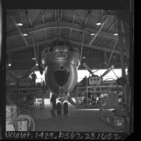 Air National Guard maintenance crews working on Stratofreighter in hanger at Van Nuys Airport, Calif., 1966