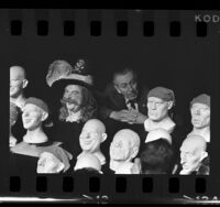 "Walt Disney with unfinished plastic heads of pirates for the ""Pirates of the Caribbean"" ride, Anaheim, 1966"