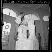 "Eino Romppanen with his statue, ""Oneness"", Calif., 1966"