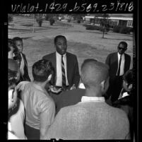 Baseball player Johnny Roseboro speaking with students at Ralph J. Bunche Junior High School in Los Angeles, Calif., 1966