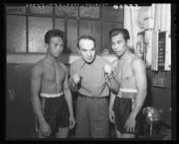 Trainer Louis Ficorilli coaching two Filipino boxers in Los Angeles, Calif., 1949