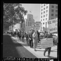 """Fire fighters with signs reading """"Long Hours Kill Firefighters Fast!,"""" picketing Los Angeles City Hall, Calif., 1966"""