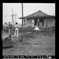 High school students cleaning up abandoned Southern Pacific railroad station in Watts, Calif., 1966