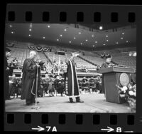 Regent Edward W. Carter, UCLA's Clark Kerr and Britain's Prince Philip on stage during presentation of honorary law degree to Prince Philip in Los Angeles, Calif., 1966