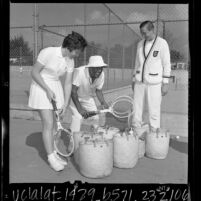 Billie Jean Moffitt King, Pancho Segura, and Stan Smith at tennis clinic in Los Angeles, Calif., 1966