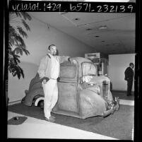"Artist, Edward Kienholz with his work ""Back Seat Dodge-38,"" Los Angeles, Calif., 1966"