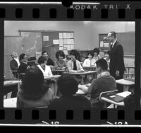 Instructor Marvin D. Follet conducting Japanese language class to Japanese American high school students in Gardena, Calif., 1966