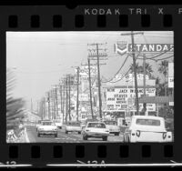 Traffic and billboards along commercial strip of Harbor Blvd. in Anaheim, Calif., 1966