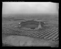 Aerial view of a crowd filled Anaheim Stadium and surrounding area on it's opening day April 9, 1966