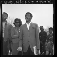 """Student Akida Kamani with other students speaking in """"Free Speech Area"""" on Cal State Los Angeles campus, Calif., 1966"""