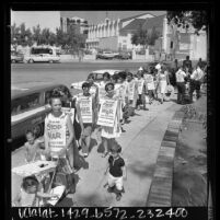 "Women Strike for Peace members wearing signs reading ""Stop This War Voter's Peace Pledge…"" marching at Old Plaza in Los Angeles, Calif., 1966"