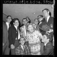 Comedienne Phyllis Diller being awarded honorary house mother of Alpha Epsilon Pi Fraternity at UCLA, 1966