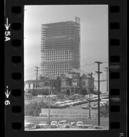 Victorian houses on Bunker Hill with steel frame of 42-story Union Bank building rising behind them, Los Angeles, Calif., 1966
