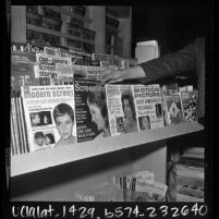 News stand with magazine covers featuring Jackie Kennedy and Mia Farrow, 1966