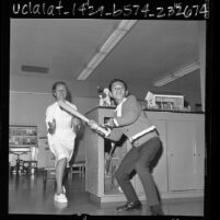 Minh Son Nguyen playing baseball with therapist Edith Gillespie at Orthopaedic Hospital in Los Angeles, Calif., 1966