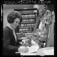 Paula Harford, audio visual clerk working at splicing unit in film unit of Pomona Public Library, Calif., 1966