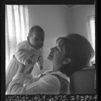 Nancy Sorio Hernandez with her infant daughter Delvina, Calif., 1966