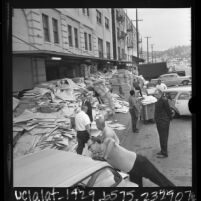 Workers unloading ballots and other voting paraphernalia at Registrar of Voters warehouse in Los Angeles, Calif., 1966