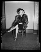 Actress Carole Landis seated in court during divorce from Willis Hunt Jr., 1940