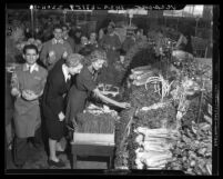Opening of Ralph's Market: view inside the store of vegetable area with shoppers in Los Angeles, Calif , 1941