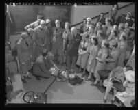 Members of the Woman's Ambulance and Defense Corps learning first-aid methods, Calif., 1941