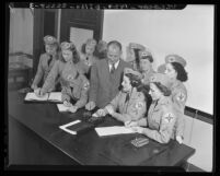 Women's Ambulance and Defense Corps of America members studying radio operations, Calif., 1941