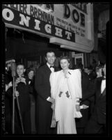"Actors Barbara Stanwyck and Robert Taylor at the film premiere of  ""Meet John Doe"" in Los Angeles, Calif., 1941"
