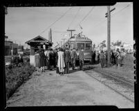 Crowd gathered around Red Car train taking actor Jimmy Stewart to U.S. Army, Westwood, Calif., 1941