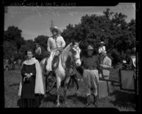 Actor Leo Carrillo and Irvin S. Cobb at Palm Sunday service for El Camino Real Horse Trails Association on Providencia Rancho, Calif., 1941