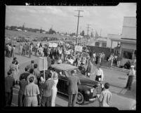 Artists on strike at Disney film studios parading near entrance in Los Angeles, Calif., 1941