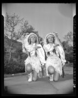 Chippewa twins giving salute that ends rifle drill at Indian Day Festival in Los Angeles, Calif., 1943