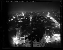 Nighttime cityscape seen from city hall tower looking west, during dim-out in Los Angeles, Calif., 1943