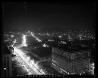 Nighttime cityscape seen from city hall tower looking northwest, during dim-out in Los Angeles, Calif., 1943